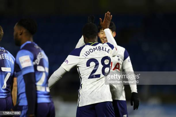 Tanguy Ndombele of Tottenham Hotspur celebrates after scoring their sides third goal with team mate Son Heung-Min during The Emirates FA Cup Fourth...