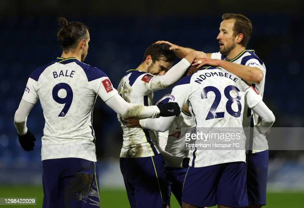 Tanguy Ndombele of Tottenham Hotspur celebrates after scoring their sides fourth goal with team mates Gareth Bale, Harry Winks and Harry Kane during...