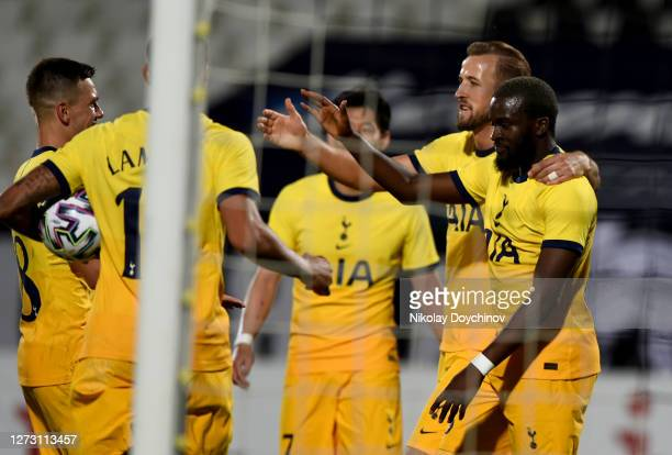 Tanguy Ndombele of Tottenham Hotspur celebrates with teammates after scoring his sides second goal during the UEFA Europa League second qualifying...