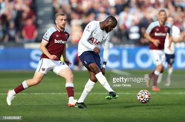 Tanguy Ndombele of Tottenham Hotspur controls the ball whilst under pressure from Jarrod Bowen of West Ham United during the Premier League match...