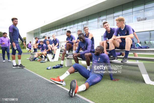 Tanguy Ndombele of Tottenham Hotspur cools down with team mates after training on July 15 2019 in Enfield England