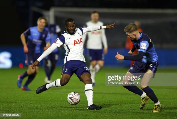 Tanguy Ndombele of Tottenham Hotspur looks to break past Josh Knight of Wycombe Wanderers during The Emirates FA Cup Fourth Round match between...