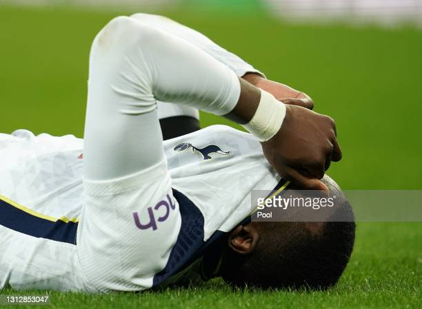 Tanguy Ndombele of Tottenham Hotspur reacts after a tackle during the Premier League match between Everton and Tottenham Hotspur at Goodison Park on...