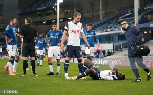 Tanguy Ndombele of Tottenham Hotspur receives medical treatment during the Premier League match between Everton and Tottenham Hotspur at Goodison...