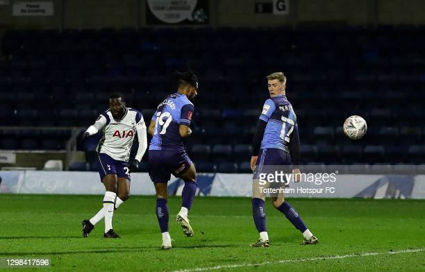Tanguy Ndombele of Tottenham Hotspur scores their sides fourth goal past Gareth McCleary and Josh Knight of Wycombe Wanderers during The Emirates FA...