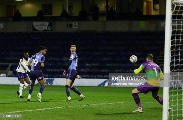 Tanguy Ndombele of Tottenham Hotspur scores their sides fourth goal past Gareth McCleary, Josh Knight and Ryan Allsop of Wycombe Wanderers during The...