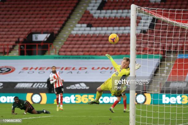 Tanguy Ndombele of Tottenham Hotspur scores their side's third goal as Aaron Ramsdale of Sheffield United attempts to save during the Premier League...