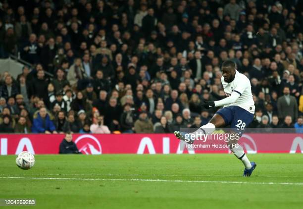 Tanguy Ndombele of Tottenham Hotspur shoots which results in an own goal scored by Jack Stephens of Southampton which lead to the first goal for...