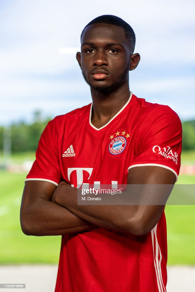 Tanguy Nianzou Kouassi of FC Bayern Muenchen poses for a photo ...