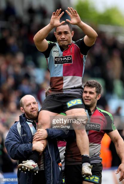Tani Fuga of Harlequins is carried off by his team mates after his last game during the Guinness premiership match between Harlequins and Sale Sharks...