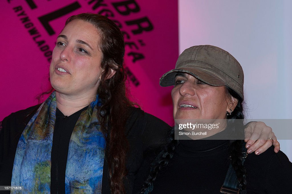 Tania Bruguera (L) poses with and Teresa Margolles as Margolles is announced as the winner of the Artes Mundi 5 prize at the National Museum Cardiff by chair of the judging panel, Tim Marlow on November 29, 2012 in Cardiff, Wales. The Award ceremony was attended by all of the shortlisted artists as well as the first minister of Wales, Rt Hon Carwyn Jones AM. Teresa Margolles was chosen from the shortlist of seven international artists and their work is currently being shown at an exhibition at the museum that will close 31 January 2013.