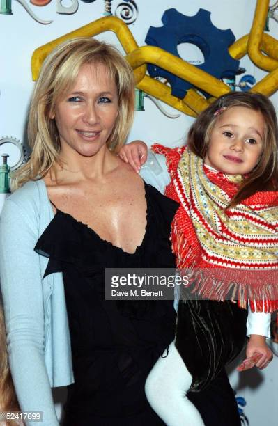 Tania Bryer and an unidentified guest arrive at the UK premiere of the animated film 'Robots' at Vue Leicester Square March 14 2005 in London
