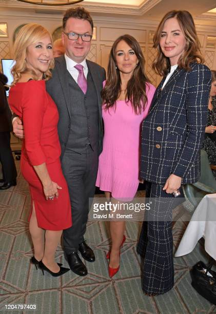 Tania Bryer, Fortnum & Mason CEO Ewan Venters, Elizabeth Hurley and Trinny Woodall attend Turn The Tables 2020 hosted by Tania Bryer and James...