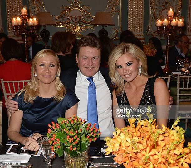 Tania Bryer Rod Barker and Claire Caudwell attend a dinner hosted by John Caudwell on March 5 2014 in London England