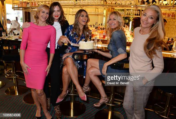 Tania Bryer, Trinny Woodall, Elizabeth Hurley, Melissa Odabash and Tamara Beckwith attend the World's Biggest Coffee Morning hosted by Elizabeth...