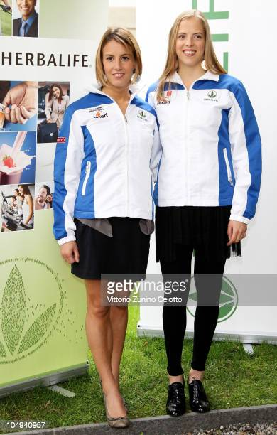 Tania Cagnotto and Carolina Kostner attend the Herbalife Press Conference held at Four Seasons Hotel on October 7 2010 in Milan Italy
