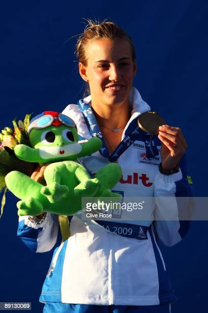 Tania Cagnotto of Italy receives the bronze medal in theWomen's 3m Springboard Final at the Stadio del Nuoto on July 21 2009 in Rome Italy
