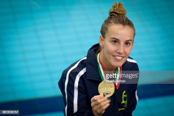 Tania Cagnotto shows her gold medal after the Women's 1m springboard Final during the 2017 Indoor Diving Italian Championships Tania Cagnotto...