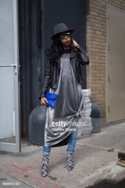 Tania Cascilla is seen attending Vivienne Tam during New York Fashion Week while wearing a silver dress with blue bag and grey hat on February 15...