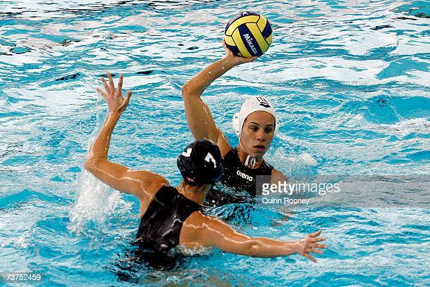 Tania Di Mario of Italy attempts to pass over Cora Campbell of Canada in the Women's 5th6th Place Water Polo match between Italy and Canada at the...