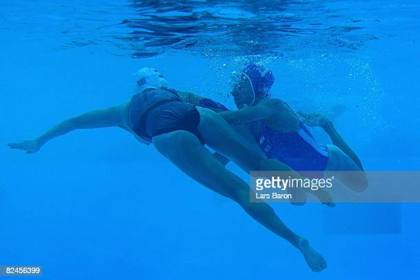Tania Di Mario of Italy He Jin of China fight under water during the women's classification 5th6th place match at the Ying Tung Natatorium on Day 11...