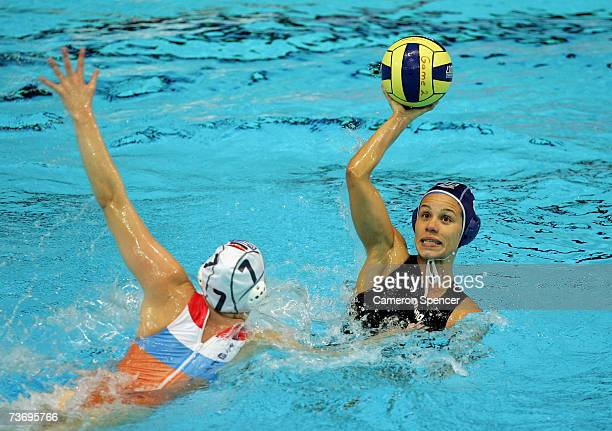 Tania Di Mario of Italy looks to pass with Lefke Van Belkum of the Netherlands in defence during the Women's Final Round Water Polo match between the...
