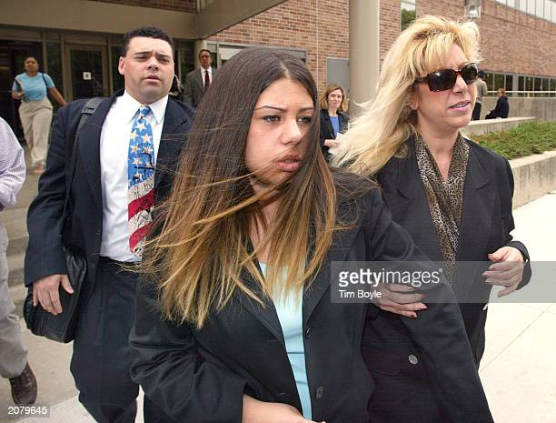 Tania Dionissopoulos departs the Cook County Courthouse with her attorney Sam Adam Jr and her mother June 11 2003 in Skokie Illinois Dionissopoulos...