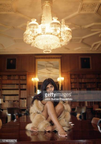Tania Duckworth, model, child star, actress and singer from Ceylon poses wearing a fur coat, circa October 1967, at Longleat, the ancestral home of...