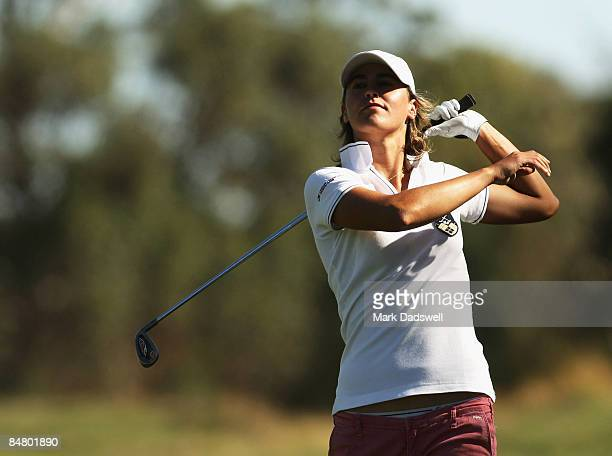 Tania Elosegui of Spain lets go of the club after miss hitting her approach shot on the 18th during day four of the 2009 Women's Australian Open held...