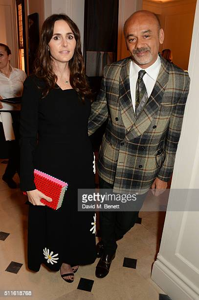 Tania Fares and Christian Louboutin attend as mytheresacom and Burberry celebrate the new MYT Woman at Thomas's on February 21 2016 in London England