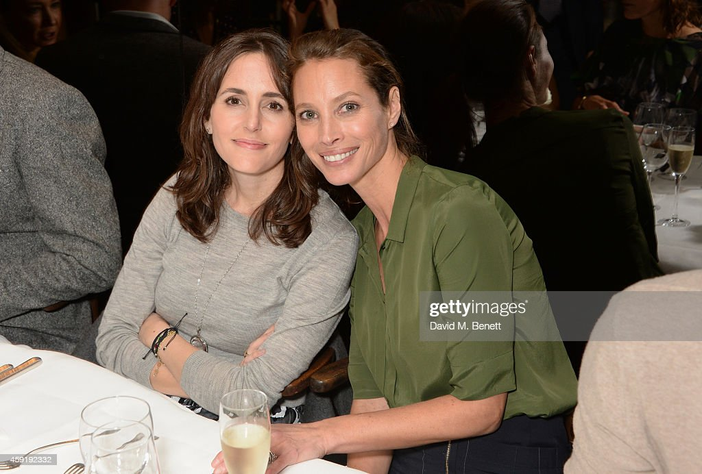 Tania Fares (L) and Christy Turlington Burns attend a dinner hosted by PORTER in honour of cover girl Christy Turlington Burns and her charity Every Mother Counts at Mr Chow on November 18, 2014 in London, England.