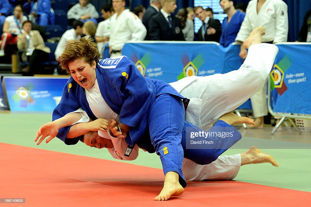 Tania Ferrera of Italy (blue) throws Kirsty Rodgers of Great Britain for a wazari (7 points) in their o78kgs reperchage contest with Ferrera eventually winning by an ippon then winning bronze in her next match during day 2 of the London British Open Judo Championships at the K2 on May 12, 2013 in Crawley, United Kingdom.