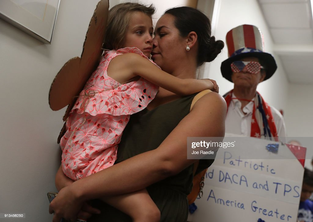 Tania Gunn holds her daughter Eva Gunn as they join with other activists in front of the office of Sen. Bill Nelson (D-FL) to ask him to help recipients of the Deferred Action for Childhood Arrivals (DACA) as well as all immigrants living in America on February 2, 2018 in West Palm Beach, Florida. The events organizers expressed their concerns about the current political landscape and how they feel it is contributing to the persecution and discrimination of documented and undocumented immigrants.