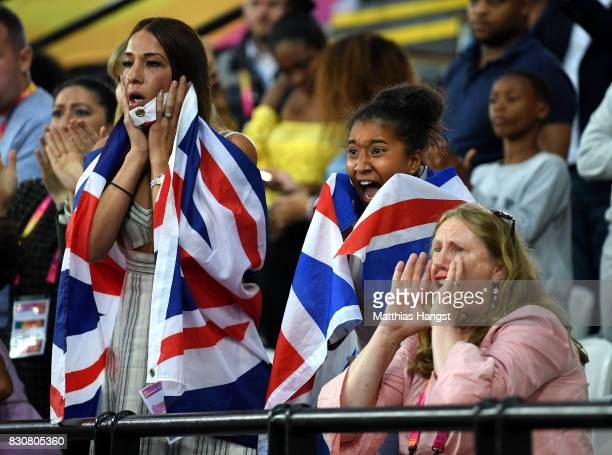 Tania Nell wife of Mohamed Farah and Daughter Rihanna show their dejection as he finishes second in the Men's 5000 Metres final during day nine of...