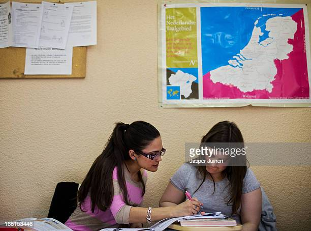 Tania Sanchez 25 yearsold from Seville works with Lucia San Miquel 27 yearsold from Gijon during their daily Dutch language class preparing them for...