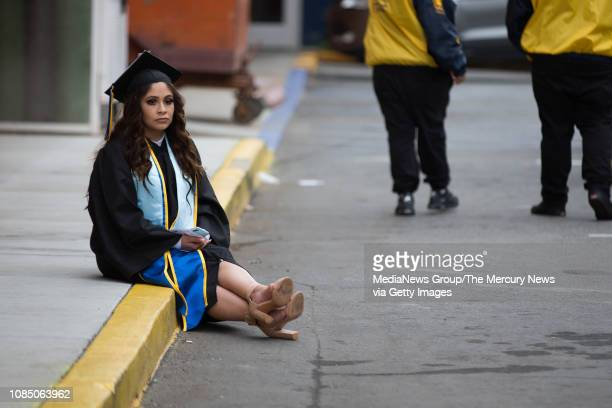 Tania Soto sits by herself before San Jose State University fall commencement at the Event Center in San Jose Calif on Wednesday Dec 19 2018