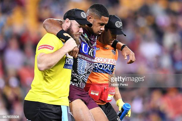 Taniela Paseka of the Sea Eagles is carried off the field injured during the round ten NRL match between the Manly Sea Eagles and the Brisbane...