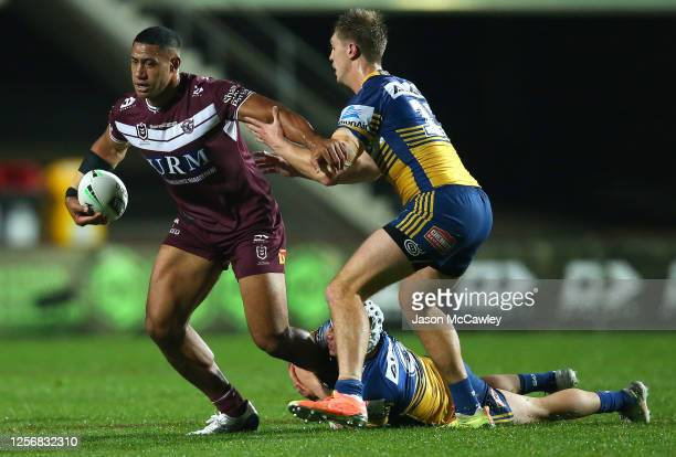 Taniela Paseka of the Sea Eagles is tackled during the round 10 NRL match between the Manly Sea Eagles and the Parramatta Eels at Lottoland on July...