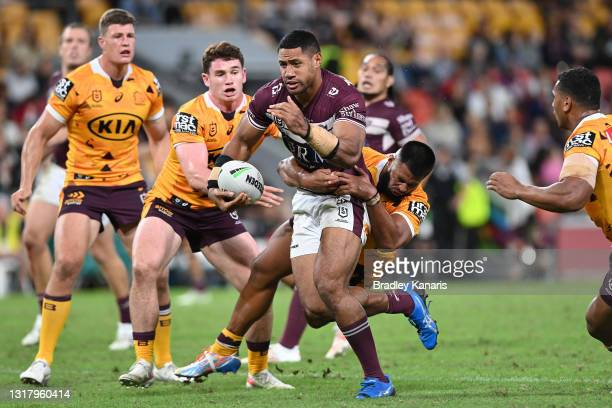Taniela Paseka of the Sea Eagles is tackled during the round 10 NRL match between the Manly Sea Eagles and the Brisbane Broncos at Suncorp Stadium on...
