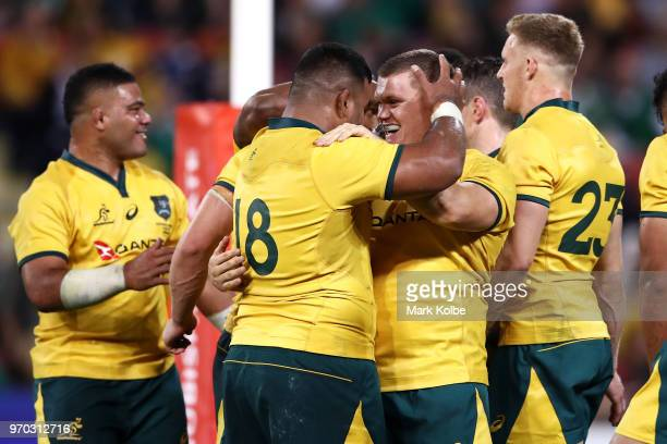 Taniela Tupou and Tom Robertson of the Wallabies celebrate victory during the International Test match between the Australian Wallabies and Ireland...