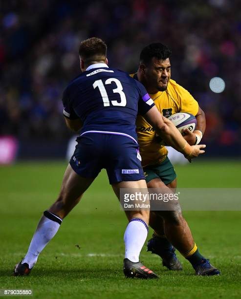 Taniela Tupou of Australia is tackled by Huw Jones of Scotland during the International match between Scotland and Australia at Murrayfield Stadium...