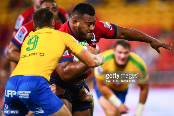 Taniela Tupou of the Queensland Reds is tackled by Northern Bulls' Andre Warner during the Super Rugby match between Australia's Queensland Reds and...
