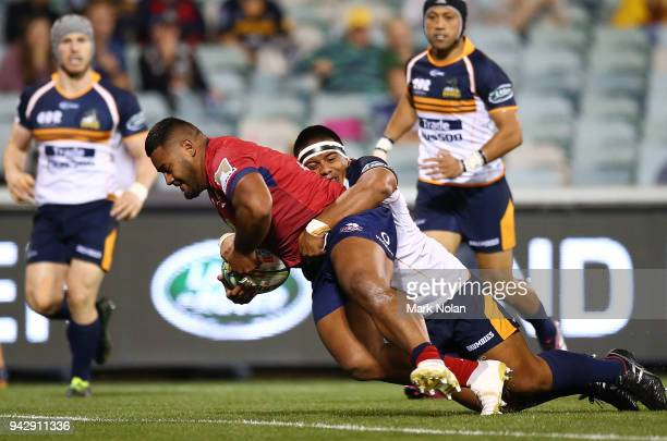 Taniela Tupou of the Reds crosses the line to score during the round 8 Super Rugby match between the Brumbies and the Reds at University of Canberra...