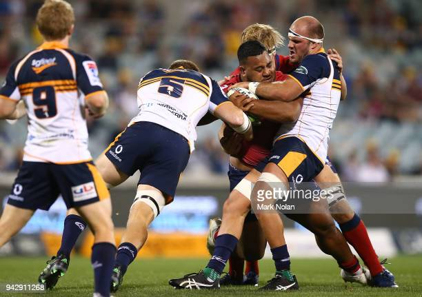Taniela Tupou of the Reds is tackled during the round 8 Super Rugby match between the Brumbies and the Reds at University of Canberra Oval on April 7...