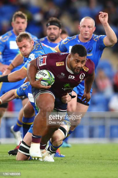 Taniela Tupou of the Reds is tackled during the round eight Super Rugby AU match between the Western Force and the Queensland Reds at Cbus Super...