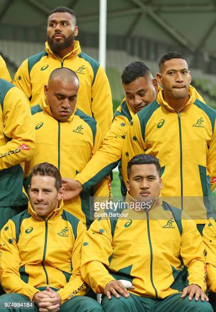 Taniela Tupou of the Wallabies gestures towards Bernard Foley of the Wallabies as Israel Folau of the Wallabies looks on at the team photo during an...