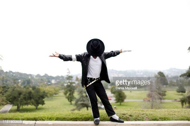 Tanisha Woods poses for a portrait at the Holly Terrace Grand Mausoleum where Michael Jackson is buried on the tenth anniversary of his death at...