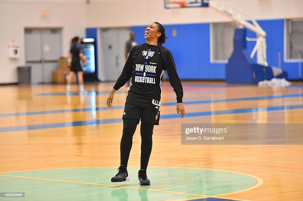 Tanisha Wright #30 of the New York Liberty smiles during practice at the New York Knicks training facility on September 25, 2015 in Tarrytown, New York