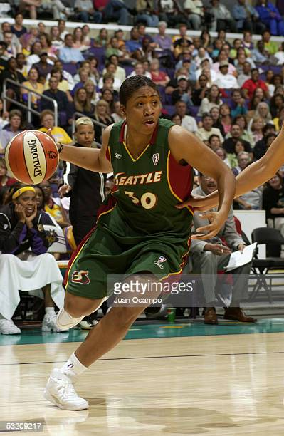 Tanisha Wright of the Seattle Storm drives against the Los Angeles Sparks during the game on June 24 2005 at Staples Center in Los Angeles California...
