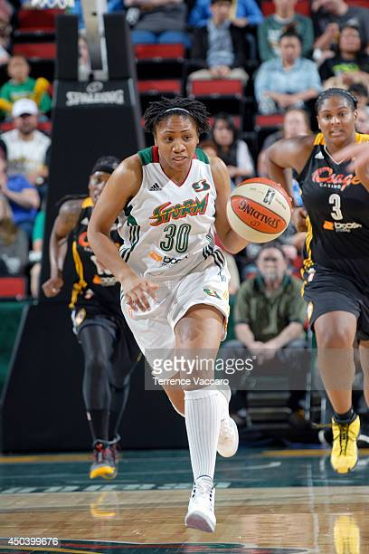 Tanisha Wright of the Seattle Storm drives against the Tulsa Shock on June 12014 at Key Arena in Seattle Washington NOTE TO USER User expressly...